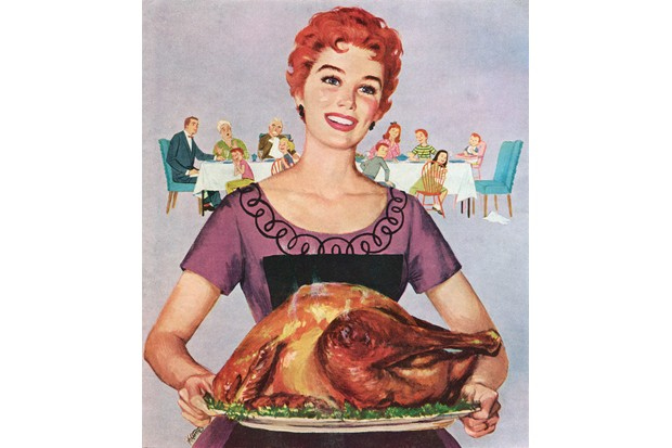A 1950s illustration of an American woman presenting a Thanksgiving turkey to her family. (Illustration by GraphicaArtis/Getty Images)