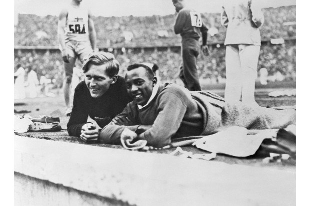 Competitors Luz Long and Jesse Owens during the 1936 Berlin Olympics. Long, the European record holder, offered Owens advice on how to adjust his run-up to make the qualifying distance during the event. (Photo by Bettmann/Getty Images)