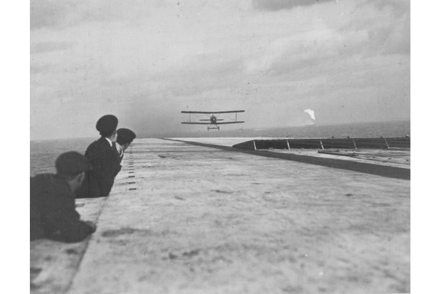 An aircraft lands on the flight deck of HMS Argus. (Photo by: Robert Hunt Library/Windmill books/UIG via Getty images)