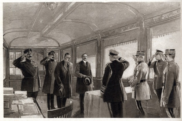 An illustration depicting signing of armistice in a railroad car on 11 November 1918. (Photo by Stefano Bianchetti/Corbis via Getty Images)