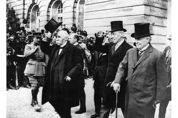 French premier Georges Clemenceau, American president Woodrow Wilson and British prime minister Lloyd George after signing the Treaty of Versailles at the end of the First World War. (Photo by Hulton-Deutsch/Hulton-Deutsch Collection/Corbis via Getty Images)