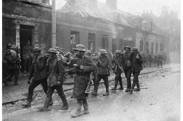 The conflict brought out not just ruthlessness and cruelty but also courage, resourcefulness, and endurance, says David Stevenson. Here, a group of wounded German and British soldiers make their way through the streets of St Quentin following the Battle of the Somme, 1916. (Photo by © Hulton-Deutsch Collection/CORBIS/Corbis via Getty Images)