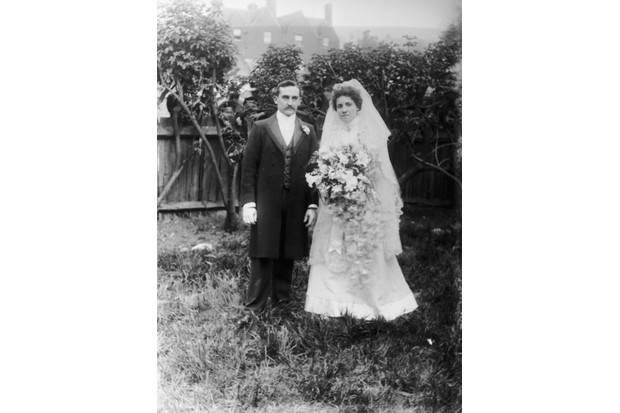 A bride and groom pose in a garden in the 1890s. Most first-time couples would have been in their mid-20s, but some did not wed until they were more financially secure. (Photo by F. J. Mortimer/Hulton Archive/Getty Images)