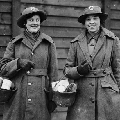 Two members of the Women's Army Auxiliary Corps find another use for discarded helmets in France during the First World War. (Alamy)