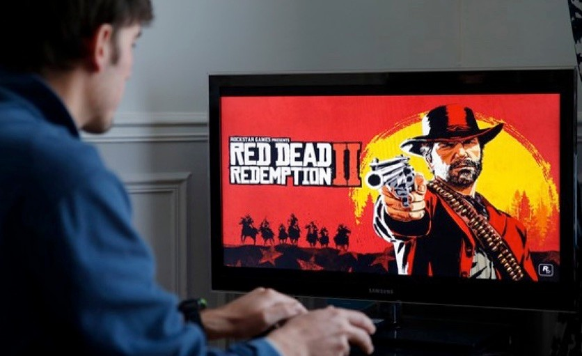 A gamer plays the video game 'Red Dead Redemption II', an action-adventure and multi-platform western video game developed by Rockstar Studios released on October 26, 2018. (Photo by Chesnot/Getty Images)