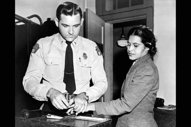 Rosa Parks being fingerprinted after her arrest