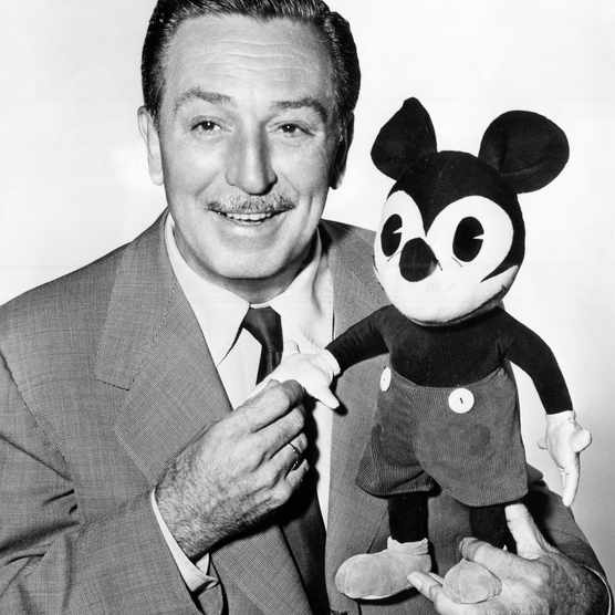 The American cartoonist and director Walt Disney with a plush puppet of Mickey Mouse, c1950s. (Photo by Mondadori Portfolio via Getty Images)