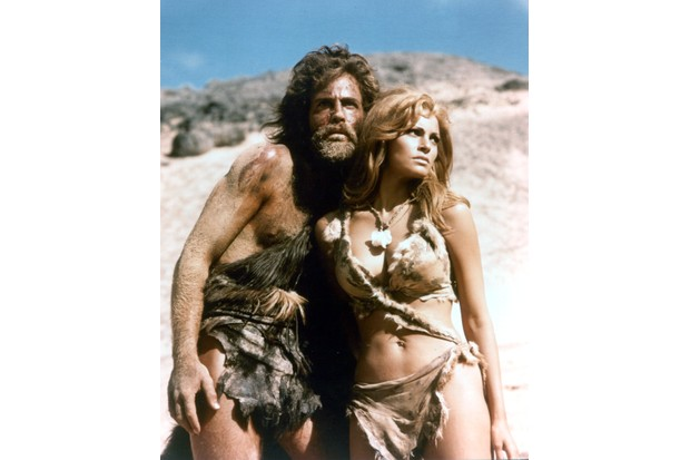 John Richardson and Raquel Welch in the film 'One Million Years B.C.', 1966. (Photo by 20th Century-Fox/Getty Images)