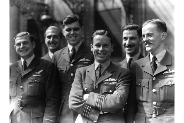 Wing Commander Guy Gibson (centre) with members of his squadron, known as 'The Dambusters'. (Photo by Keystone/Getty Images)