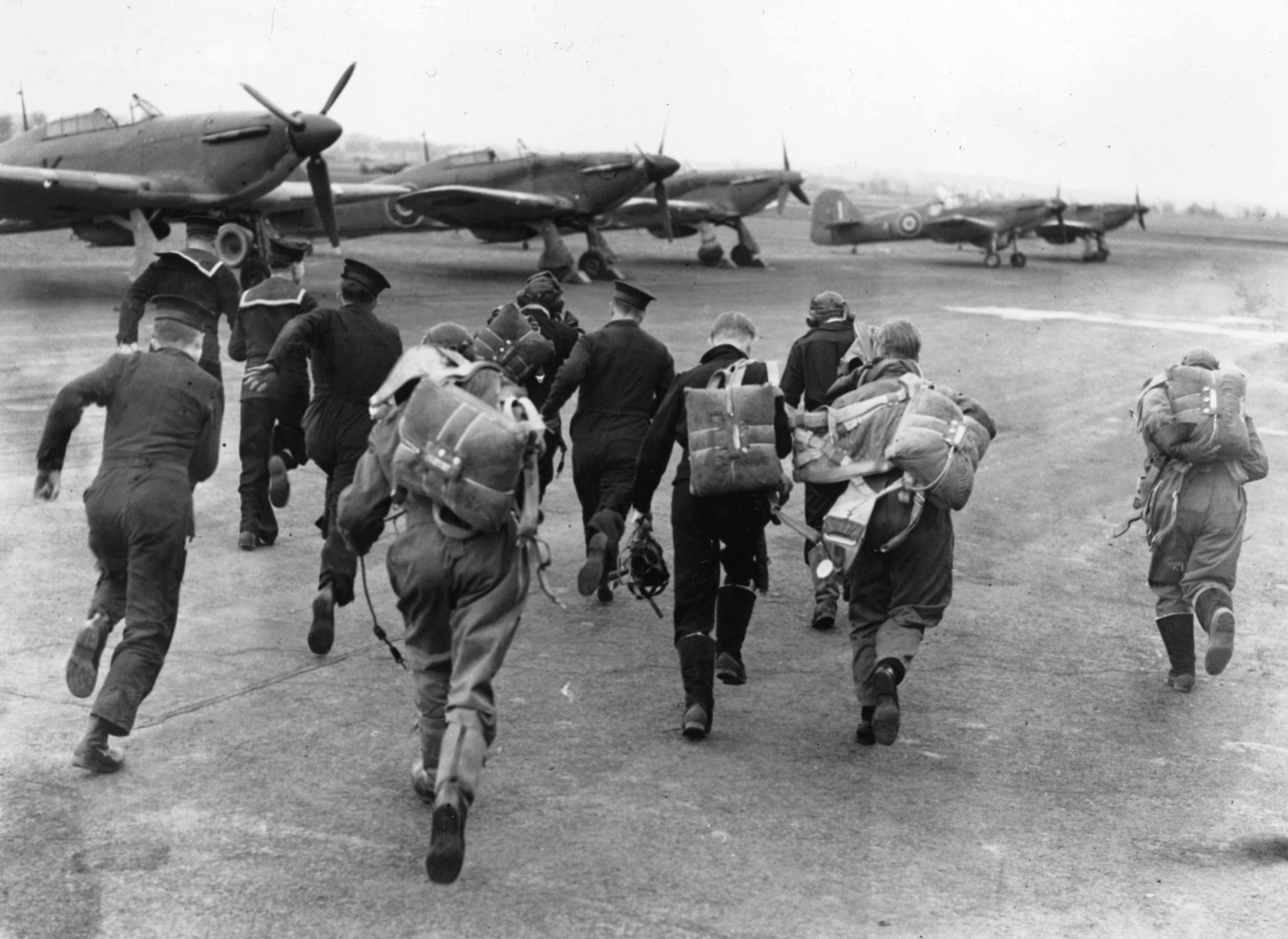 1943: A group of RAF pilots and sailors scramble for their planes during an alert at a training centre for the Fleet Air Arm. (Photo by Keystone/Getty Images)