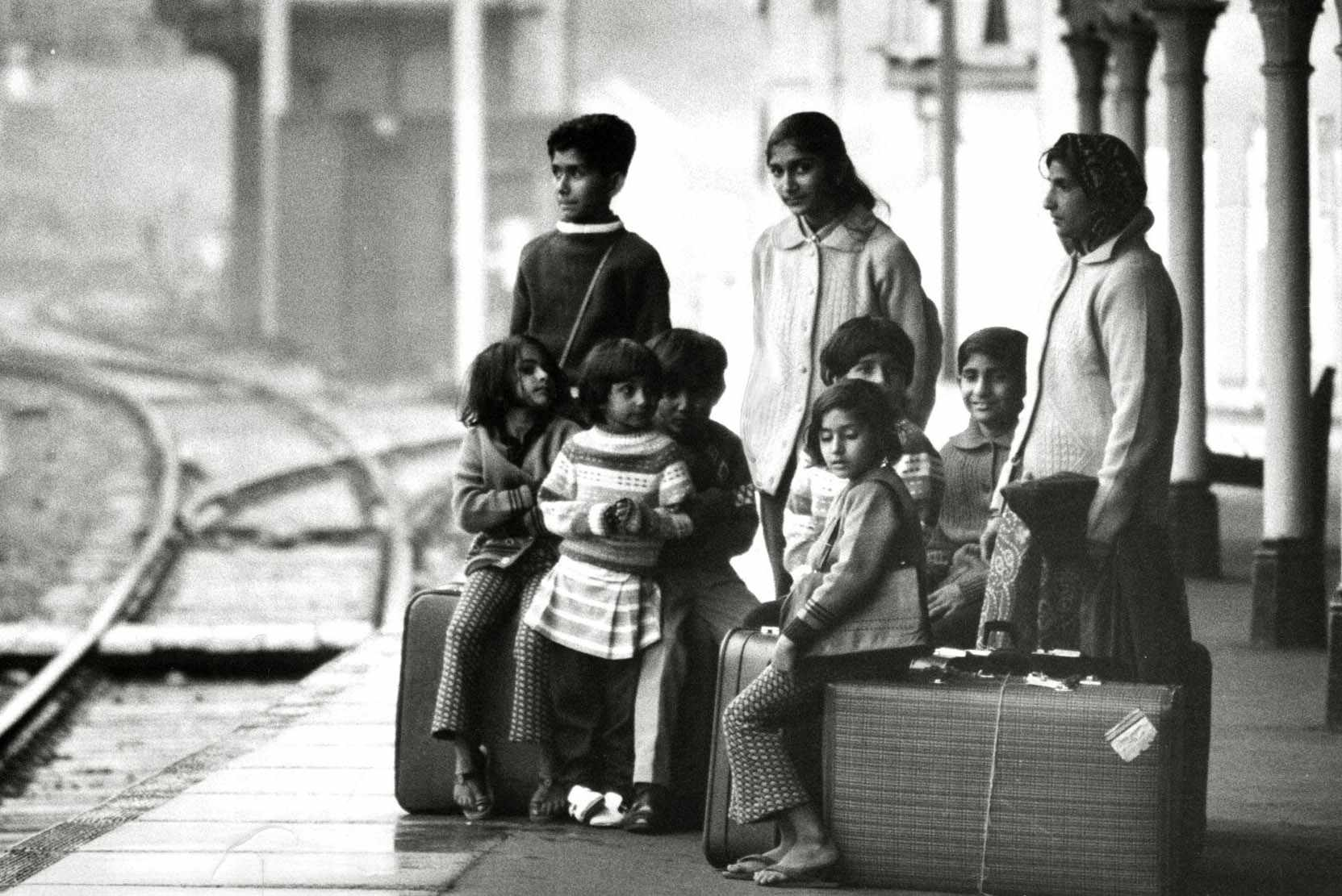 In a photograph taken at Bishop's Stortford railway station in Hertfordshire, 1972, resettled Ugandan Asians wait for the train that will take them to their new home. (Photo by Alamy)