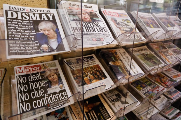 National and international newspapers on a London newsstand show reactions to the historic loss in the Brexit deal vote, 16 January 2019. (Photographer: Luke MacGregor/Bloomberg via Getty Images)