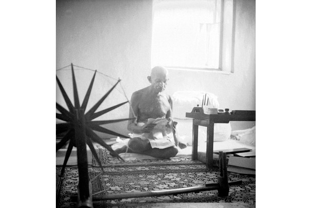 "With his dhoti and his spinning-wheel, symbol of the dignity of labour, Gandhi was, as he himself said, ""spinning the destiny of India"". (Photo by Margaret Bourke-White/The LIFE Picture Collection/Getty Images)"