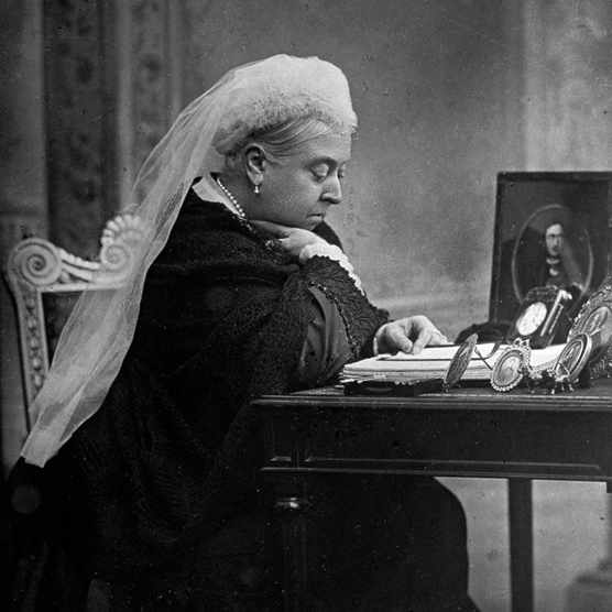 British monarch Queen Victoria seated at her writing desk, c1897. In January 1901, as illness left the queen was no longer able to carry out her constitutional duties, the government ground to a halt. (Photo by Time Life Pictures/Mansell/The LIFE Picture Collection/Getty Images)