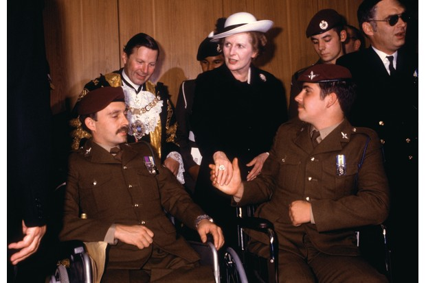 "Margaret Thatcher meets disabled veterans at the Falklands War victory parade, 1982. The prime minister's ""fierce patriotism inflated ideas of national exceptionalism"", writes Piers Brendon. (Photo by Keystone/Hulton Archive/Getty Images)"