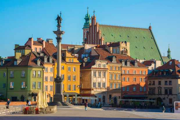 The reconstructed Castle Square offers a glimpse of how Warsaw would have looked in the past. (Photo by Alamy)