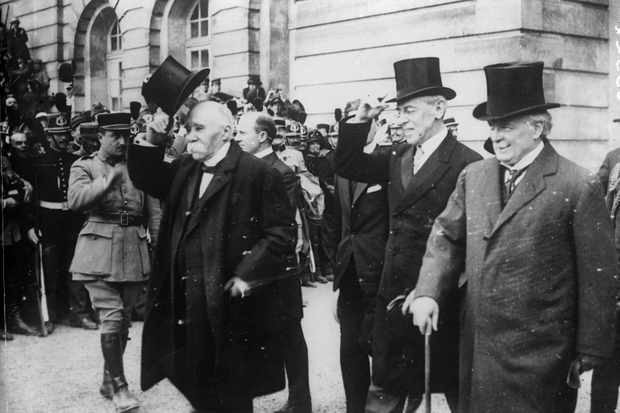 French prime minister Georges Clemenceau (left), US president Woodrow Wilson (centre) and British PM David Lloyd George at the signing of the Treaty of Versailles in June 1919. The treaty's provisions have been blamed for causing the Second World War. (Image by Topfoto)