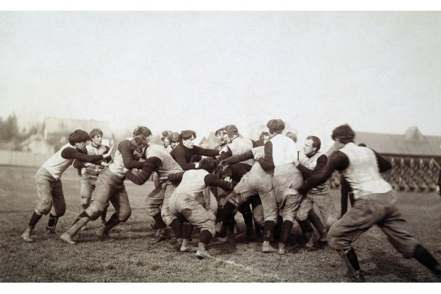 An early college football scrimmage, c1905. Early versions of the game were brutal and chaotic, resulting in many injuries. (Image by Alamy)