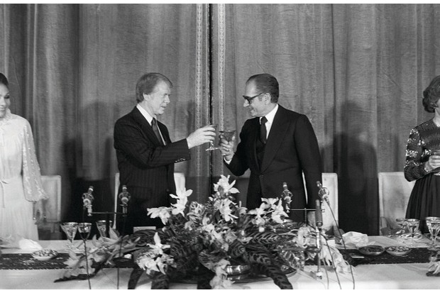"American approval: US president Jimmy Carter and Mohammad Reza Pahlavi share a toast at New Year 1978. The American leader called Iran ""an island of stability"". (Photo by Jean-Claude Deutsch/Paris Match via Getty Images)"