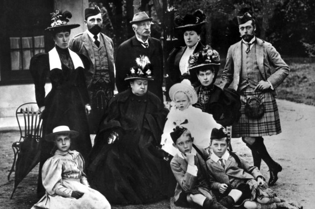 c1895: Queen Victoria with her family. Standing left to right: Princess Helena Victoria of Schleswig-Holstein; Prince Henry of Battenberg; Count Arthur Mensdorff-Pouilly; Beatrice, Princess Henry of Battenberg; George, Duke of York. Seated left to right: Princess Victoria Eugenie of Battenberg; Queen Victoria; Victoria Mary, Duchess of York holding Prince Edward of York; Prince Arthur of Connaught; and Prince Alexander of Battenberg. (Photo by Hulton Archive/Getty Images)