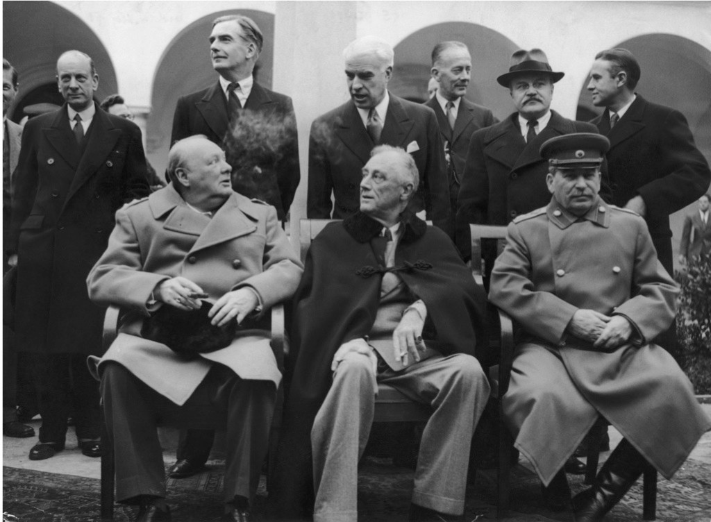 Winston Churchill, Franklin Delano Roosevelt and Joseph Stalin, seated from left to right, in Yalta for the 'Big Three' Conference. In February 1945, British diplomats were already joking that it was actually a conference of the 'Big Two-and-a-Half'. (Photo by Keystone Features/Getty Images)