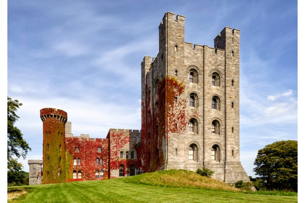 "Penrhyn Castle, Gwyneedd. In 2012, the mystery of a curious piece of graffiti etched into one of the tower windows was revealed to read ""to be loved, whilst loving"". (Photo by Getty Images)"