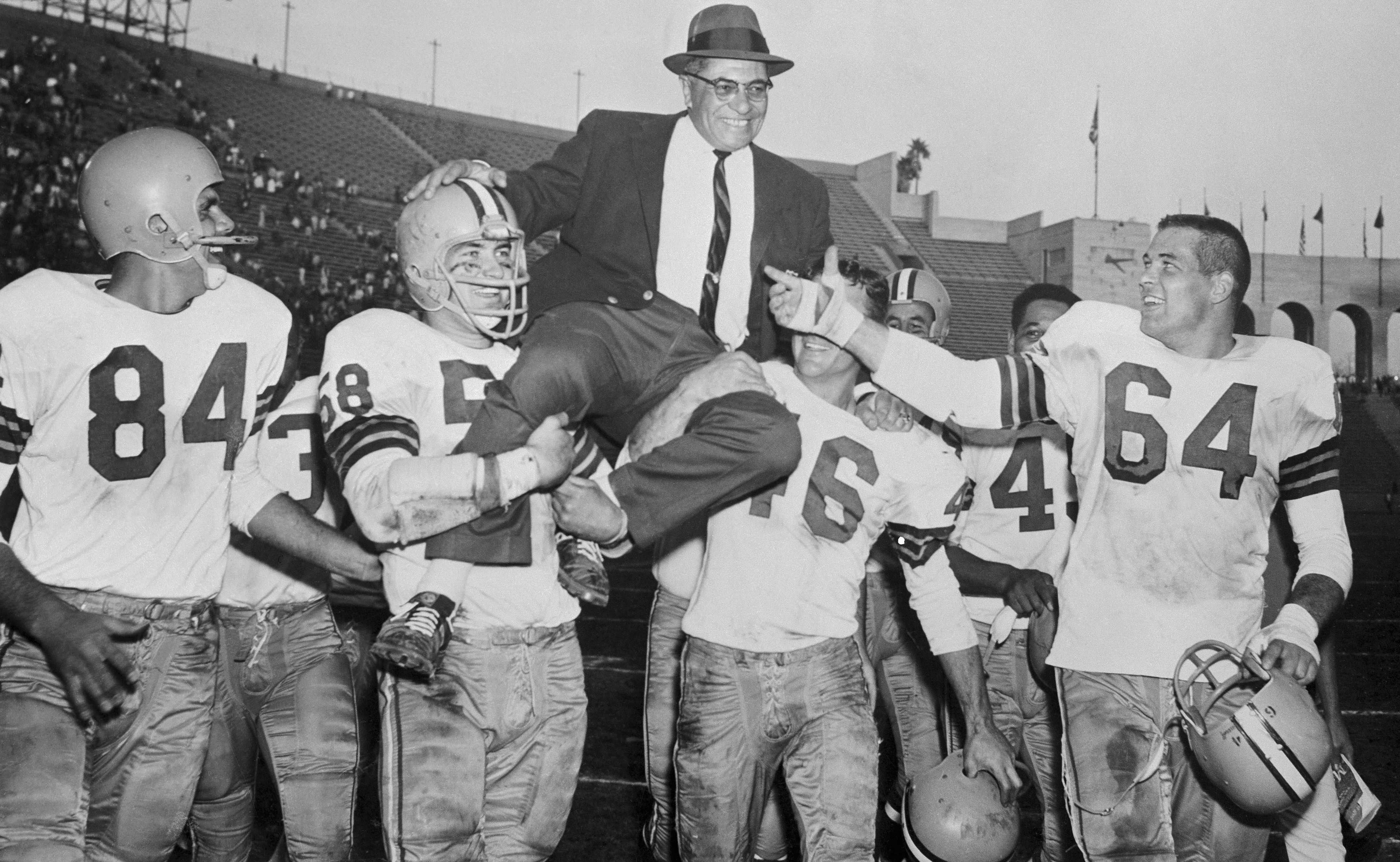 Green Bay Packers coach Vince Lombardi is held aloft by his team after clinching a division title in 1960. (Image by Bettmann/Getty Images)
