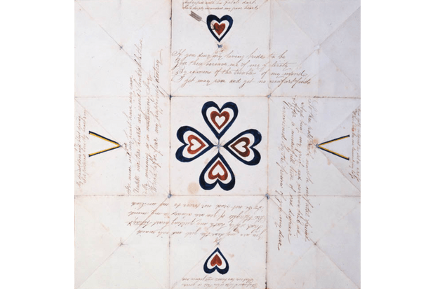 A 'puzzle purse', a popular type of card from the Georgian period that had to be unfolded in a particular way to reveal the hidden verse within. (Photo by The Postal Museum Collection)