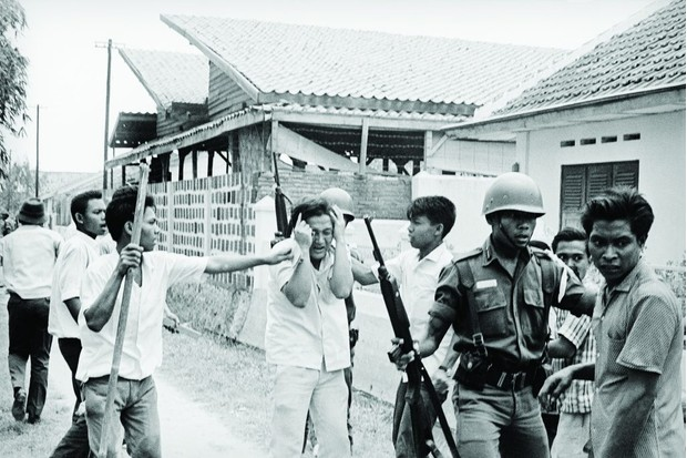 An Indonesian civilian is seized during the army-backed crackdown on communists in the mid-1960s, when several hundred thousand people were killed. Modern extremism often takes different and less obviously violent forms, says Saskia Schäfer.