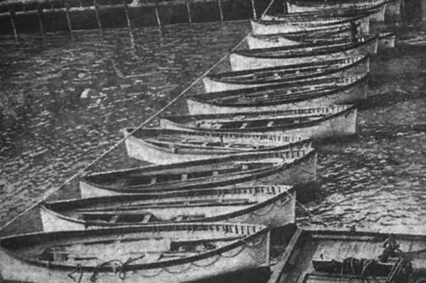 Some of Titanic's lifeboats at her New York pier after the disaster. (Authors' Collection)