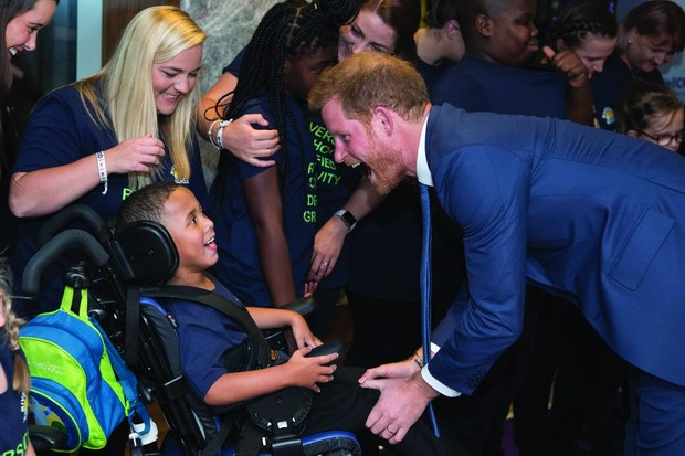 Prince Harry presents a WellChild Award in London. Like his mother before him, his approach is heartwarming. (Photo by Victoria Jones - WPA Pool/Getty Images)