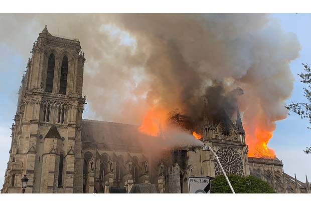 Flames and smoke are seen billowing from the roof at Notre-Dame cathedral in Paris, 15 April 2019. (Patrick Anidjar/AFP/Getty Images)