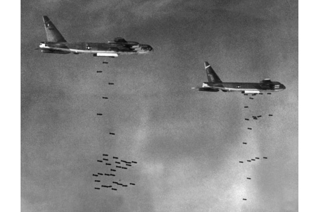 US B-52 bombers drop bombs over a Viet Cong-controlled area in South Vietnam, August 1965, during the Vietnam War. (Photo by STF/AFP/Getty Images)