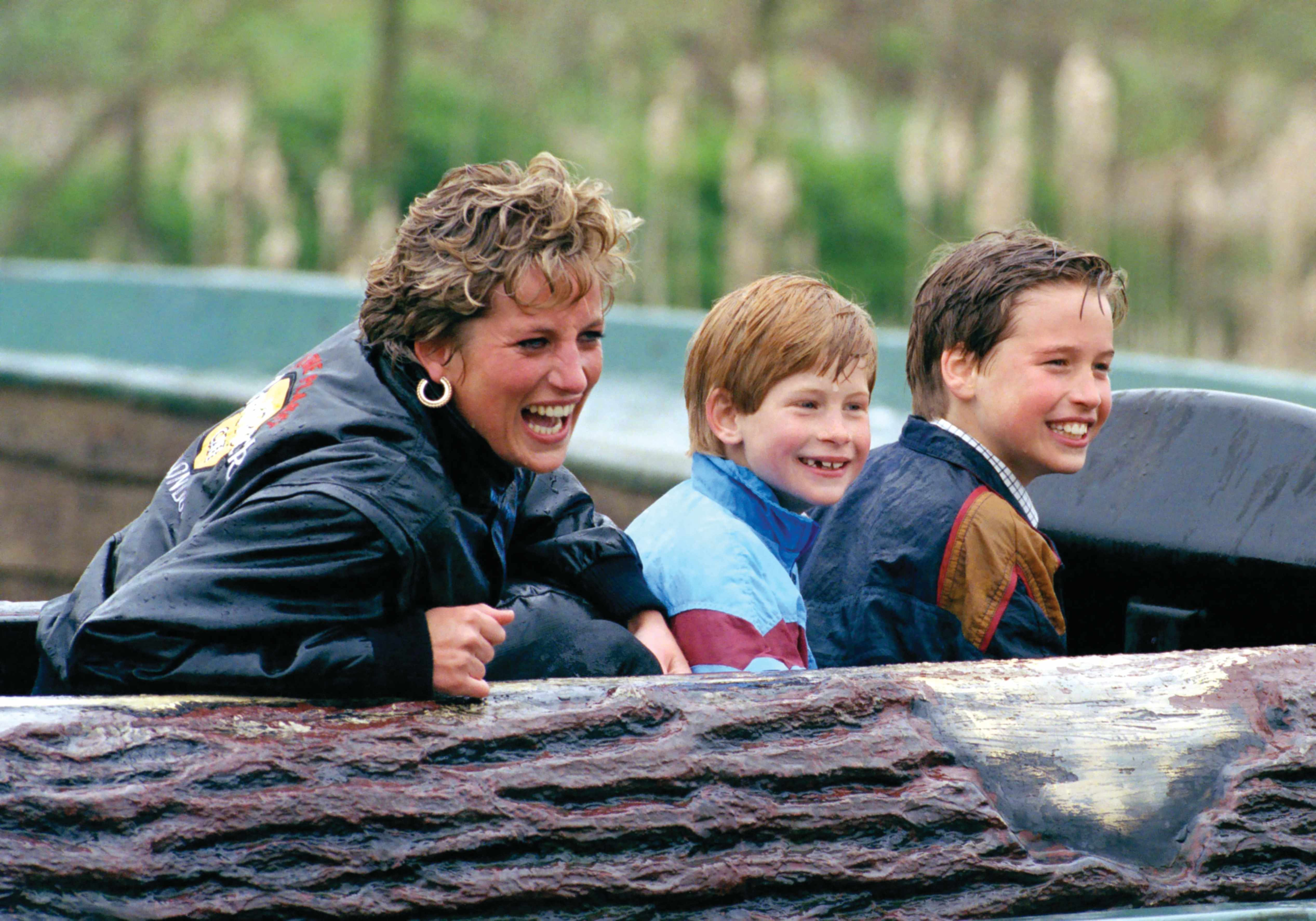 """Making a splash: Diana relishes taking her sons on a water ride at the Thorpe Park theme park in 1993. William has since recalled how his mother loved """"laughter and fun"""". (Photo by Getty Images)"""