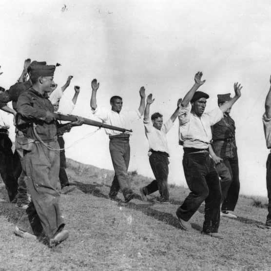 Nationalist troops escort captured Republican militia during the Spanish Civil War. (Photo by Keystone/Getty Images)