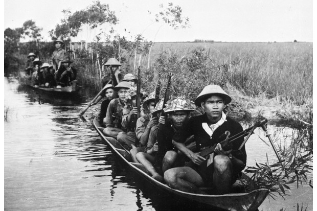 Viet Cong guerillas patrolling a water zone during the Vietnam War, March 1966. (Photo by Keystone/Getty Images)