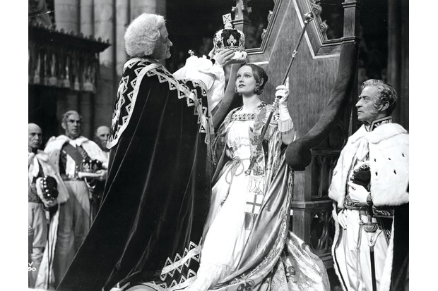Queen Victoria, played by Anna Neagle, is crowned in 'Victoria the Great' – one of the first portrayals of a reigning or recent monarch on screen. (Photo by Hulton Archive/Getty Images)