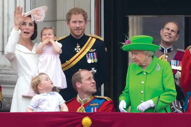 The Queen reminds Prince William that he should not be kneeling down and talking to George during the Trooping the Colour parade. (Image by JUSTIN TALLIS /AFP/ Getty Images)