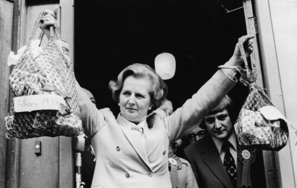 Thatcher holds up two shopping bags to show how much less a pound would buy due to inflation under Labour. (Photo by Keystone/Hulton Archive/Getty Images)