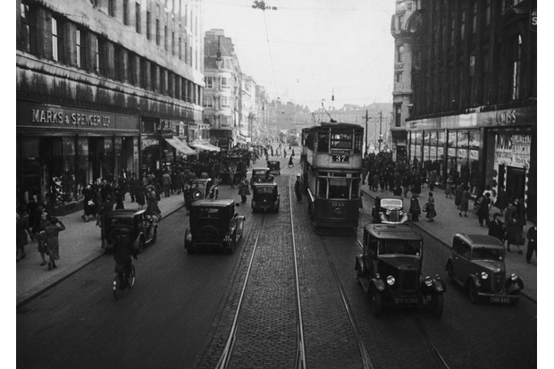 Market Street in Manchester, UK, 1938, with vehicles driving on the left-hand side. (Photo by Kurt Hutton/Picture Post/Hulton Archive/Getty Images)