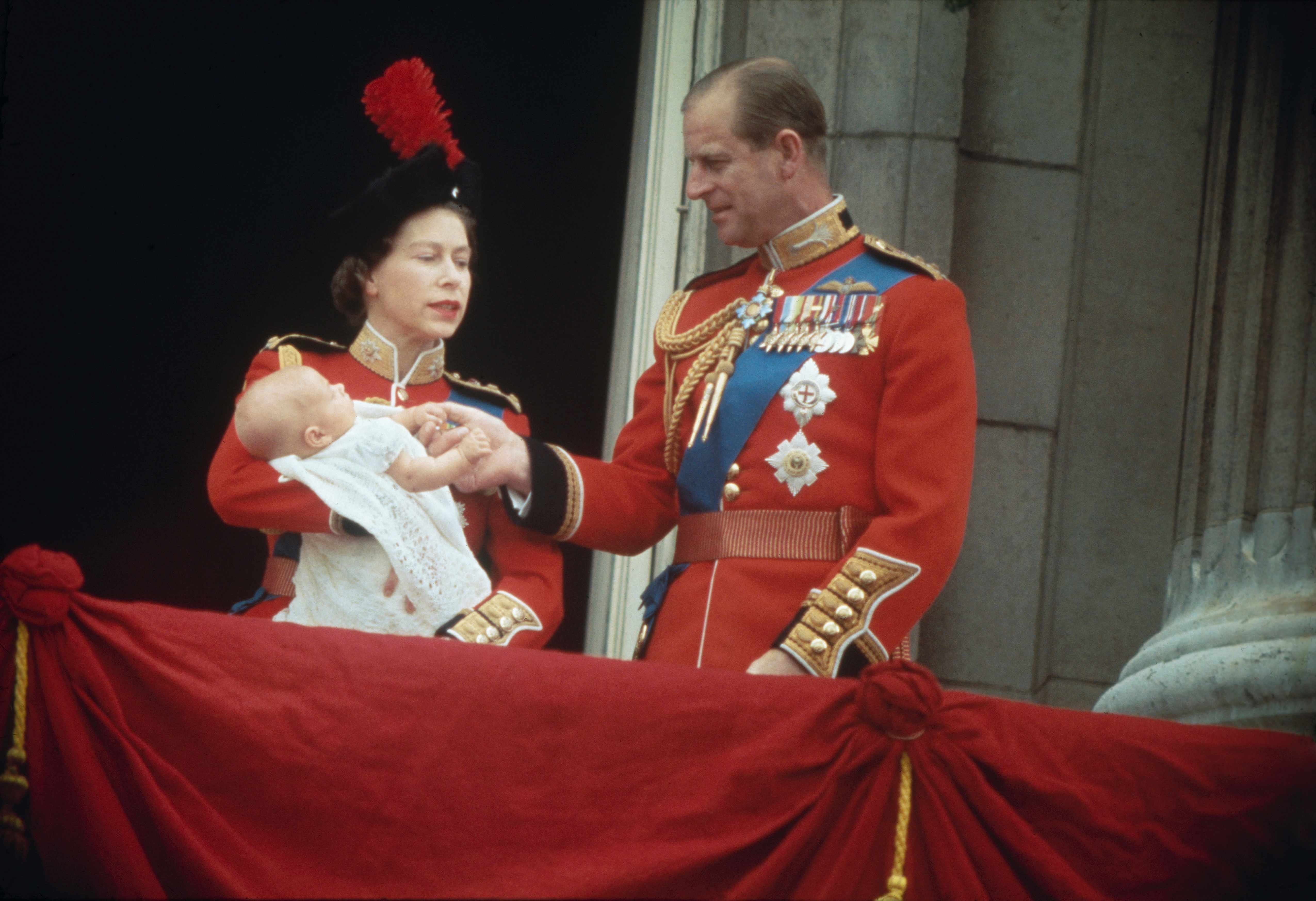 Elizabeth II and Prince Philip with their third son, Prince Edward, on the balcony at Buckingham Palace. (Photo by Fox Photos/Hulton Archive/Getty Images)