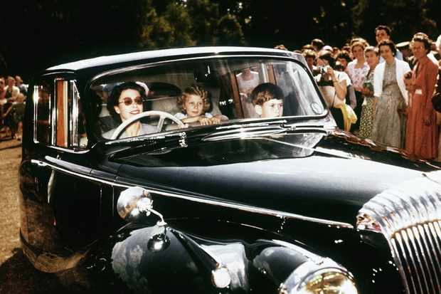 Queen Elizabeth II driving her children Prince Charles and Princess Anne at Windsor, 1957. (Photo by © Hulton-Deutsch Collection/CORBIS/Corbis via Getty Images)