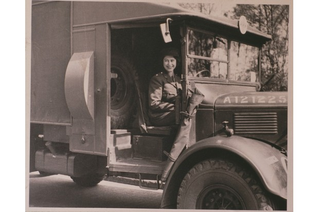 Princess Elizabeth driving an ambulance during her wartime service in the ATS during the Second World War. (Photo by Bryn Colton/Getty Images)