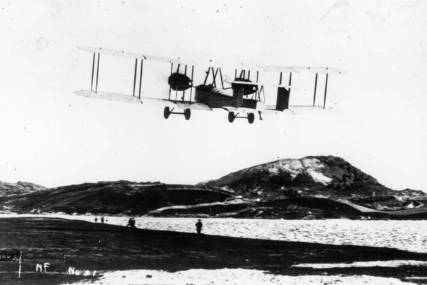 A biplane takes off from Newfoundland