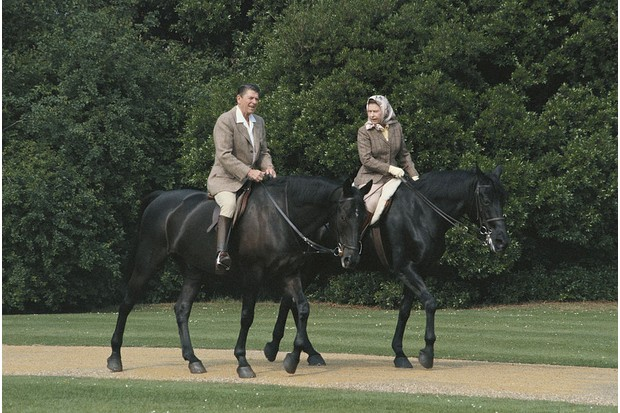 Queen Elizabeth II riding in the grounds of Windsor Castle with US President Ronald Reagan, 1982. (Photo by Georges De Keerle/Getty Images)