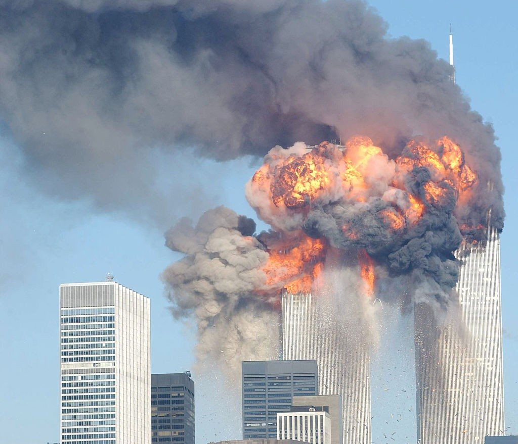 394261 12: A fiery blasts rocks the World Trade Center after being hit by two planes September 11, 2001 in New York City. (Photo by Spencer Platt/Getty Images)
