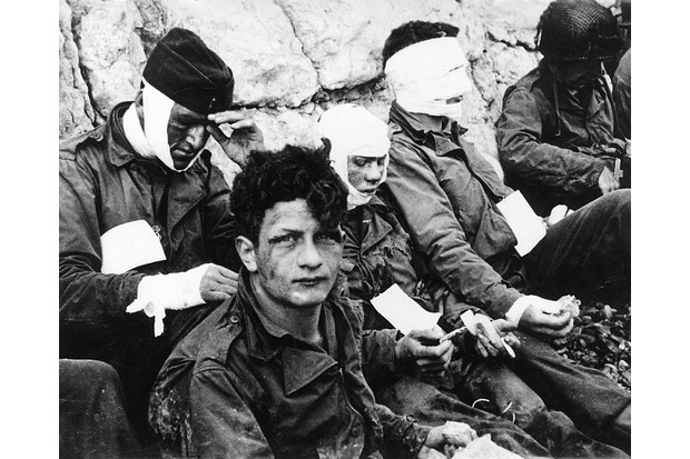 Out of action: wounded soldiers on Omaha, the bloodiest of the five beaches, where the Americans sustained more than 2,000 casualties. (Photo by Mondadori Portfolio via Getty Images)