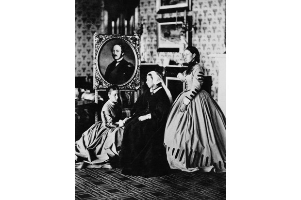 Queen Victoria at Balmoral with her daughters Princess Alice and Princess Louise, Duchess of Argyll, beside a portrait of her late husband, Prince Albert, in 1863. (Photo by Hulton Archive/Getty Images)