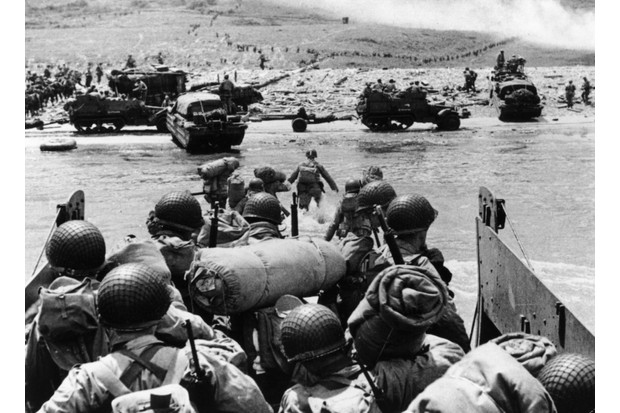 American assault troops and equipment landing on Omaha beach on the Northern coast of France on D-Day, 6 June 1944. (Photo by Fox Photos/Getty Images)