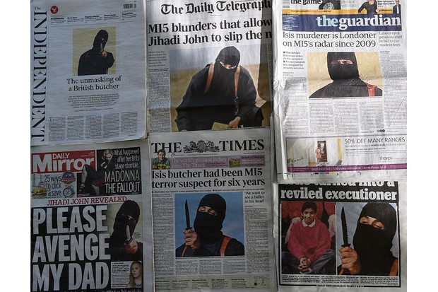 British daily newspapers from 2015 display headlines and stories regarding the identification of the masked Islamic State group militant dubbed 'Jihadi John'. Social media and other online technologies enable anyone with a keyboard to seek out extremist texts, says JM Berger. (Photo by DANIEL SORABJI/AFP/Getty Images)